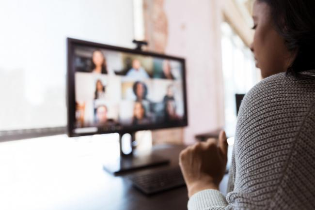 Woman attending virtual meeting